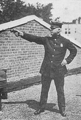 Captain Edward J Langrish firing revolver
