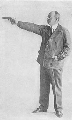 Dr. H R Brunton firing position with Colt Automatic