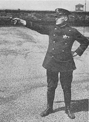 Major Joseph J Marek shooting position with revolver