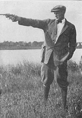 Mr Adolph P Schuber shooting position with revolver