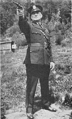 Mr George Marshall shooting position with revolver